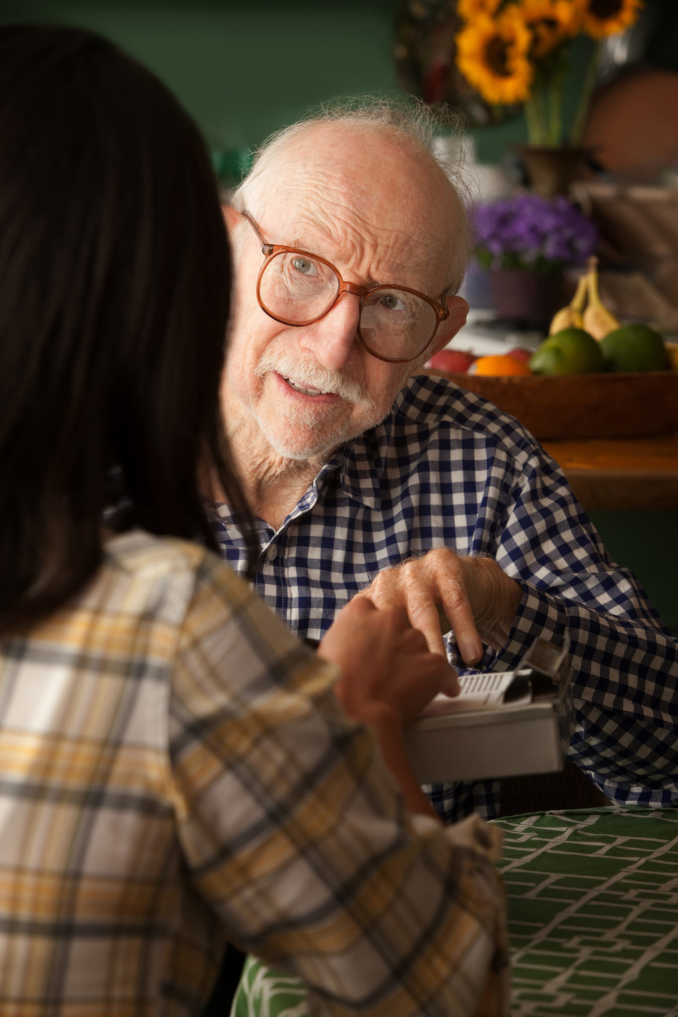 Older man talking to a woman