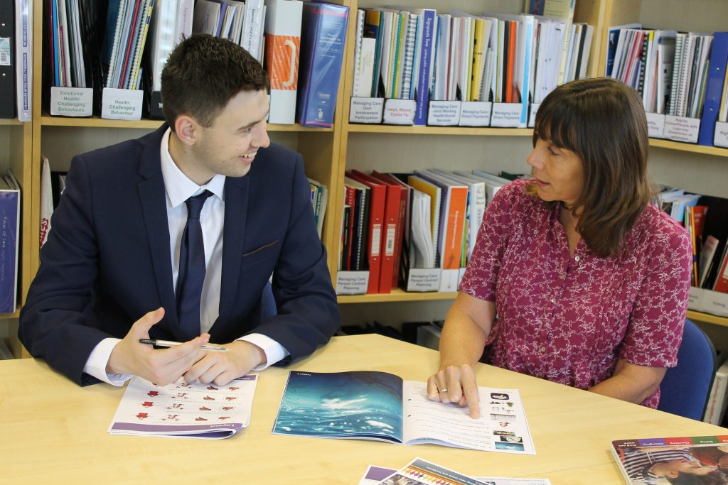 Woman and man reviewing Easy Read materials