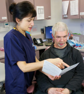 Health worker showing information to a patient