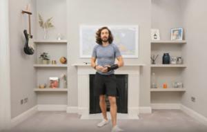 Joe Wicks doing exercises in his living room