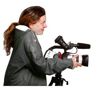 A woman is using a video camera