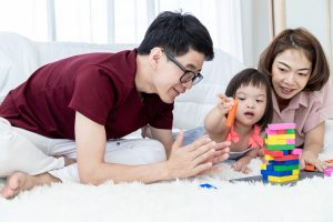 Parents playing with a child