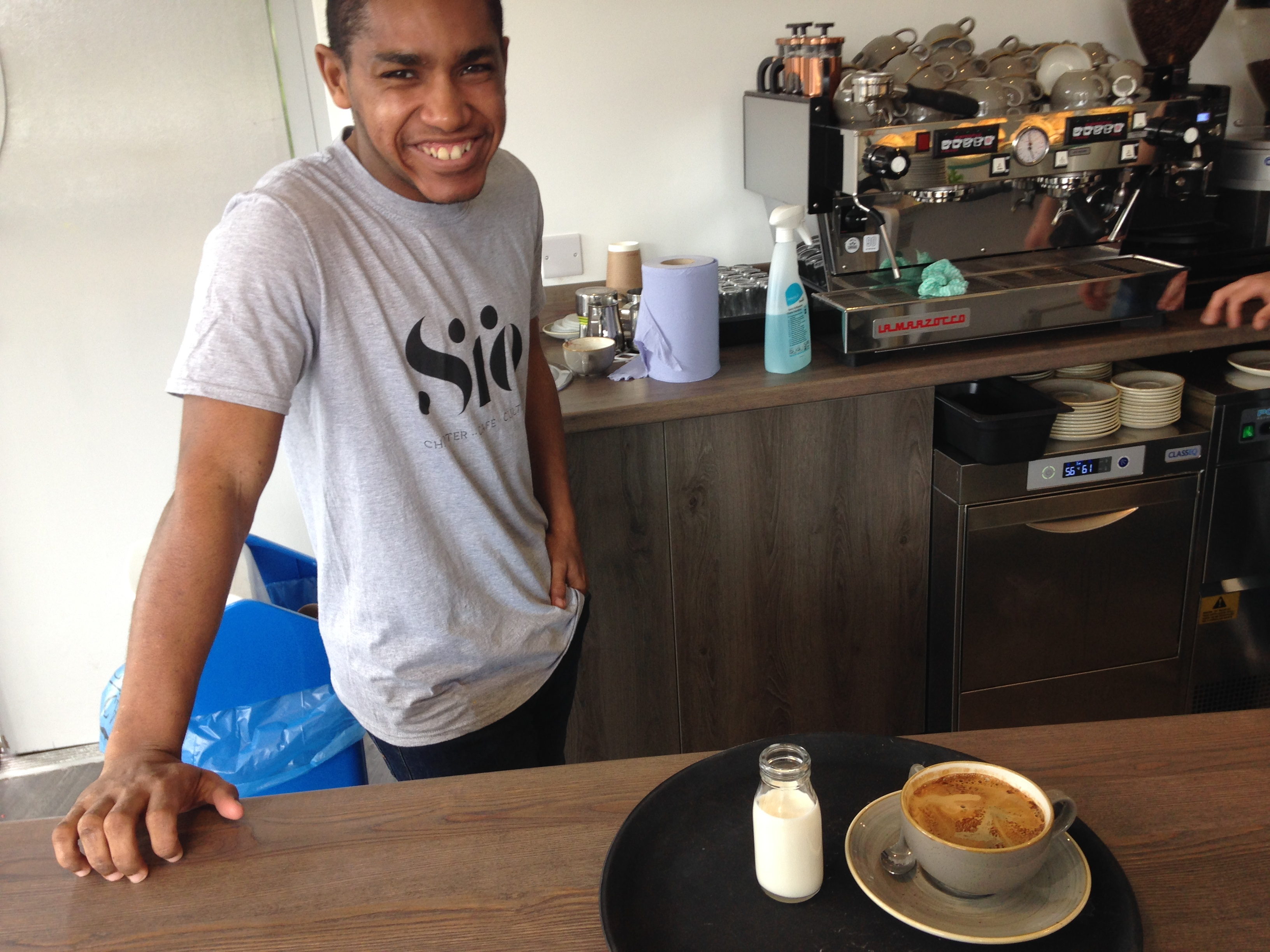 Young man working in a cafe