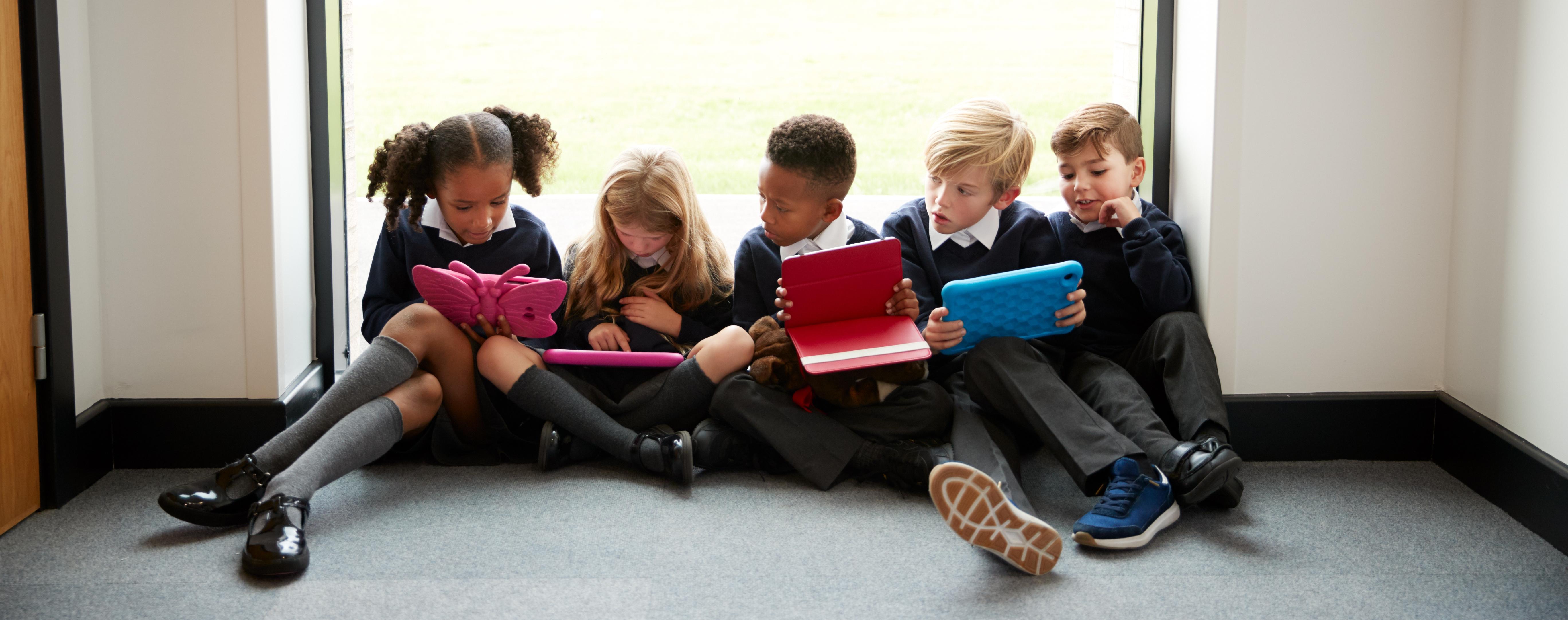 School children sitting on the floor